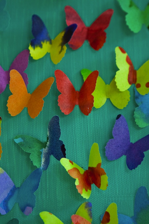 Butterflies cut from a single sheet of many colors.